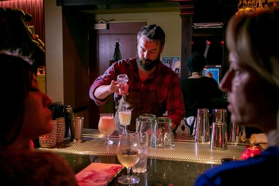 Beverage Director Issac Shumway makes a drink at  Bear vs. Bull bar in San Francisco, Calif., on Wednesday, January 20th, 2014.
