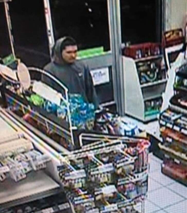 """Palo Alto Police is looking for the man pictured above after he shoplifted $40 worth of beer from a 7-Eleven and his accomplice threatened workers with a """"Taser-like"""" weapon."""
