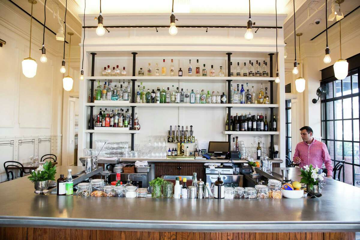 A compact and stylish bar sits near the entrance of Supper.