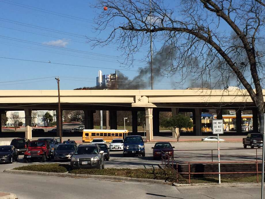 A vehicle caught fire around 3:30 p.m. Thursday, Jan. 21, 2016, on Interstate 10 just inside the Loop 410 interchange. Photo: Patrice Cross/Courtesy