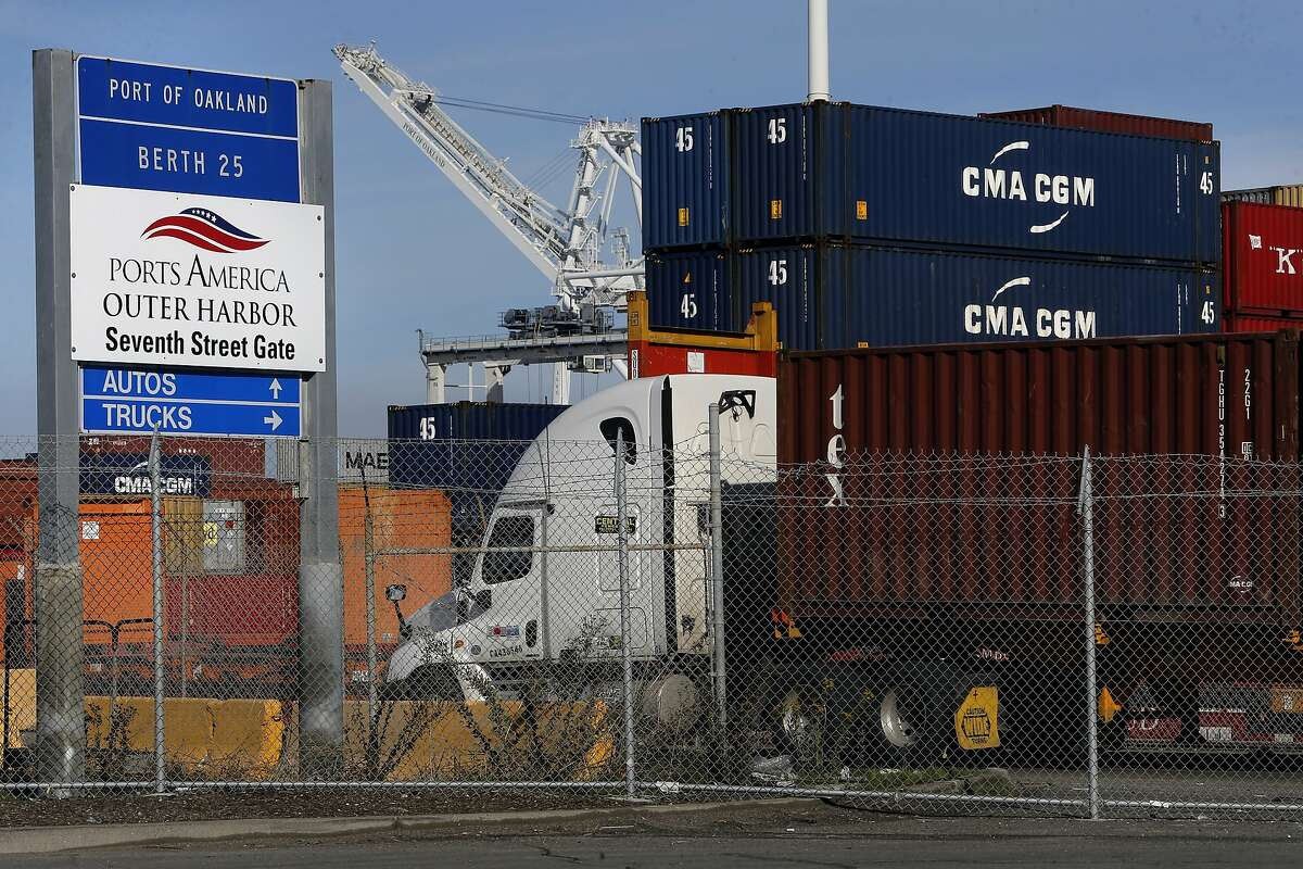 Trucks bring their loads into Ports America shipping at the outer harbor of the Port of Oakland, Calif., as seen on Thurs. January 21, 2016.