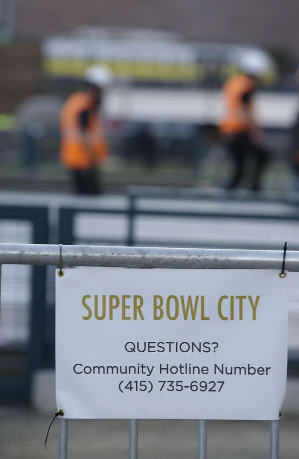 Workers from local 16 work on the bocce ball courts on the Embarcadero at the site of the Super Bowl City on Thursday, January 21, 2016 in San Francisco, Calif. Photo: Lea Suzuki, The Chronicle