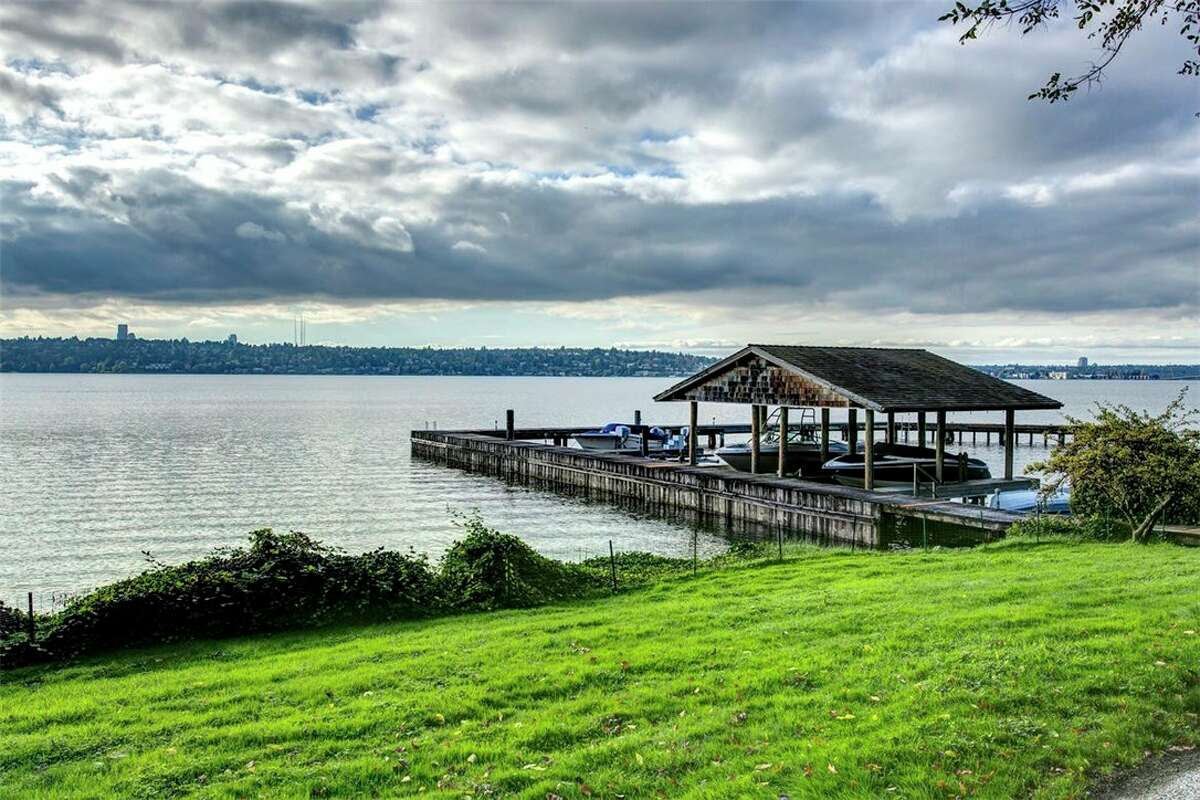 The private dock of the home. The home is also part of an exclusive community property with 300 feet of west-facing gated waterfront. It is shared with three other homes.