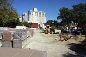 This Hemisfair site next to the playground will be the future home of a 168-unit apartment complex, wrapped around a parking garage, with retail space on the ground floor.
