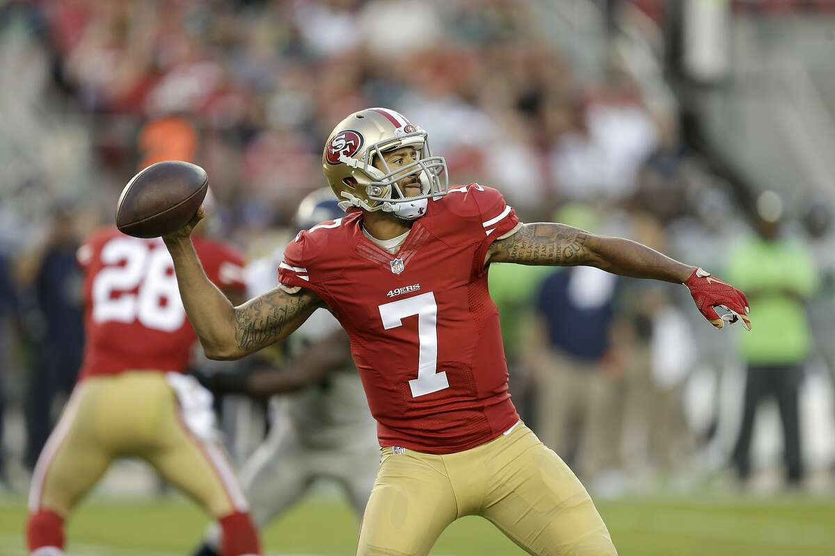 FILE: In this photo from Thursday, Oct. 22, 2015, San Francisco 49ers quarterback Colin Kaepernick (7) passes against the Seattle Seahawks during the first half of an NFL football game in Santa Clara, Calif. Kaepernick has a torn ligament in the thumb on his throwing hand and surgery has been recommended. That could happen as soon as this week once he receives a second opinion on the injury. (AP Photo/Ben Margot)
