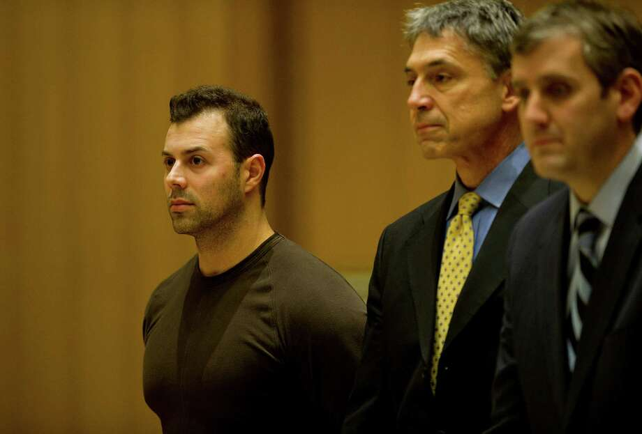 At his arraignment on an arson charge in December 2014, Anthony Manousos, 34, appears in State Superior Court with his attorneys, Frank DiScala, center and Mike Skiber, right, in Stamford, Conn. Photo: Lindsay Perry / Lindsay Perry / Stamford Advocate