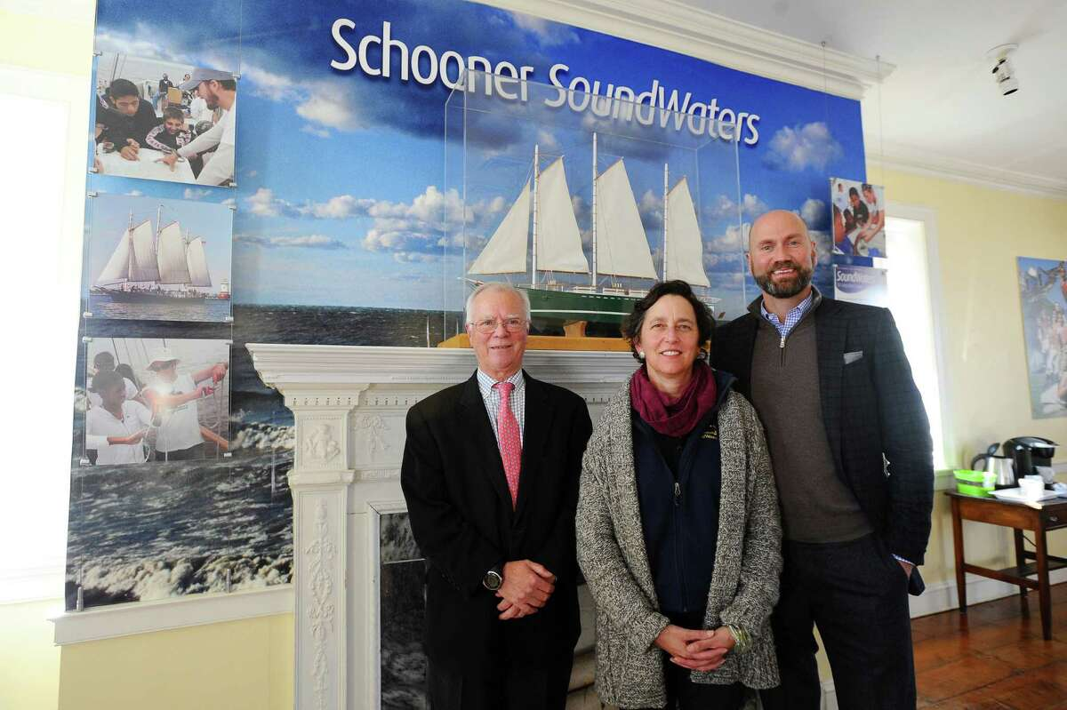 From left, Young Mariners chairman Tom O'Connell, SoundWaters president Dr. Leigh Shemitz and SoundWaters chairman Scott Mitchell pose for a picture inside the SoundWaters Coastal Education Center after announcing a merge between the two nonprofits which will enhance the educational opportunities offered to students in Stamford on Thursday, Jan. 21, 2016.