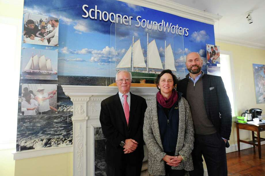 From left, Young Mariners chairman Tom O'Connell, SoundWaters president Dr. Leigh Shemitz and SoundWaters chairman Scott Mitchell pose for a picture inside the SoundWaters Coastal Education Center after announcing a merge between the two nonprofits which will enhance the educational opportunities offered to students in Stamford on Thursday, Jan. 21, 2016. Photo: Michael Cummo / Hearst Connecticut Media / Stamford Advocate