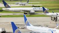 United Airlines planes sit parked on the tarmac at George Bush Intercontinental Airport on Wednesday, July 8, 2015, in
