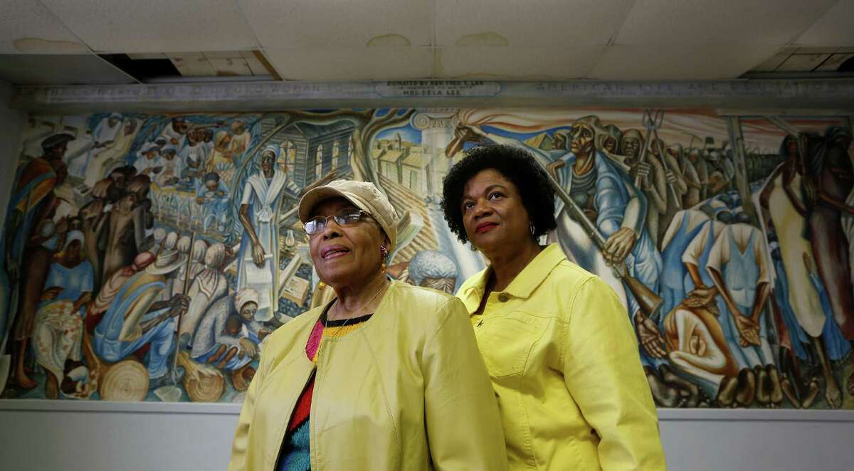 Charlotte Kelly Bryant, left, and Lucy Bremond hope to preserve the Blue Triangle Multi-Cultural Association's building and John Bigger's mural.