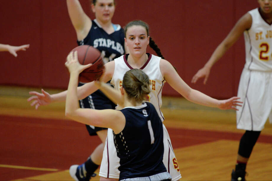 Staples' Rachel Seideman looks past St. Joseph's Megan Robertson as St. Joseph High School hosts Staples High School in varsity girls basketball in Trumbull CT on Thurs. Jan. 21, 2016. Photo: Shelley Cryan / For Hearst Connecticut Media / Connecticut Post Freelance