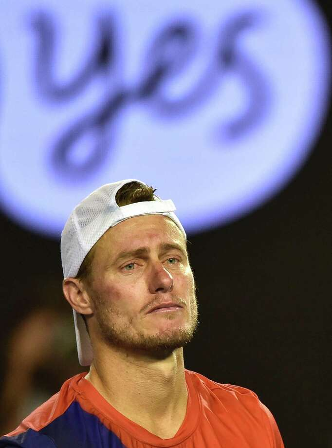 Australia's Lleyton Hewitt looks on after defeat in his men's singles match against Spain's David Ferrer on day four of the 2016 Australian Open tennis tournament in Melbourne on January 21, 2016. AFP PHOTO / PAUL CROCK-- IMAGE RESTRICTED TO EDITORIAL USE - STRICTLY NO COMMERCIAL USEPAUL CROCK/AFP/Getty Images Photo: PAUL CROCK / AFP