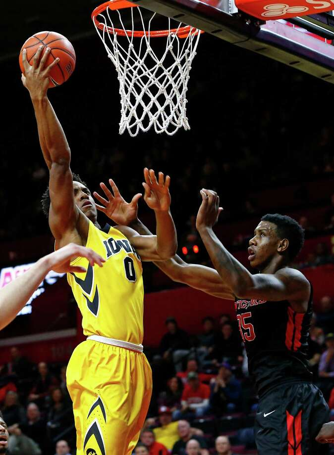 PISCATAWAY, NJ - JANUARY 21:  Ahmad Wagner #0 of the Iowa Hawkeyes attempts a layup as Greg Lewis #35 of the Rutgers Scarlet Knights defends during the first half of a college basketball game at the Rutgers Athletic Center on January 21, 2016 in Piscataway, New Jersey. (Photo by Rich Schultz /Getty Images) ORG XMIT: 600733385 Photo: Rich Schultz / 2016 Getty Images