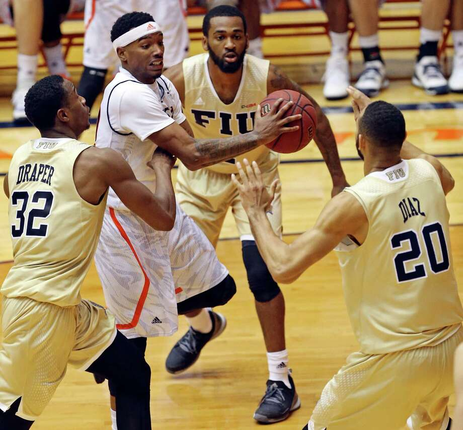 UTSA's Christian Wilson looks to pass between FIU's Daviyon Draper (from left), Donte McGill and Adrian Diaz during second half action Thursday Jan. 21, 2016 at the Convocation Center. FIU won 72-56. Photo: Edward A. Ornelas, Staff / San Antonio Express-News / © 2016 San Antonio Express-News