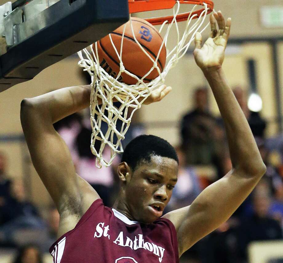 The ball hangs in a tangled net after Chrales Bassey stuffs it home for the Jackets as Central Catholic plays St. Anthony in boys basketball at Greehey Arena on January 21, 2016. Photo: TOM REEL, STAFF / SAN ANTONIO EXPRESS-NEWS / 2016 SAN ANTONIO EXPRESS-NEWS
