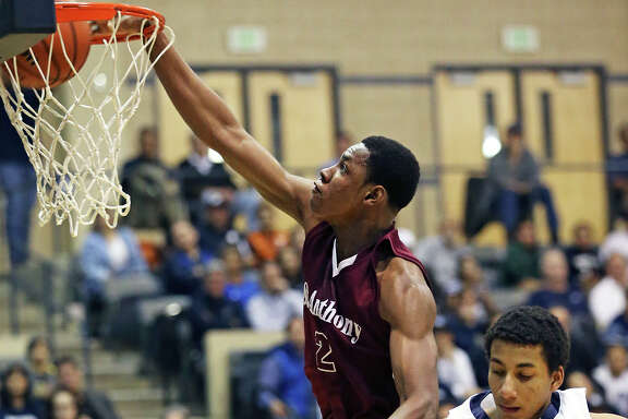 Yellow Jackets big man Charles Bassey throws down a slam as Central Catholic plays St. Anthony in boys basketball at Greehey Arena on Jan. 21, 2016.