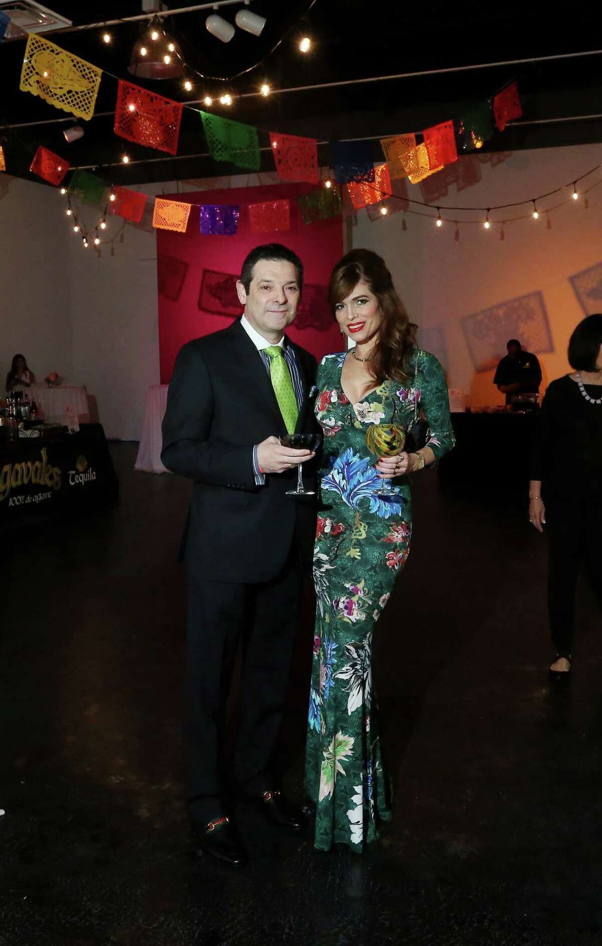 Carlos and Karina Barbieri pose for a photo at Margarita Madness Thursday, Jan. 21, 2016, in Houston.