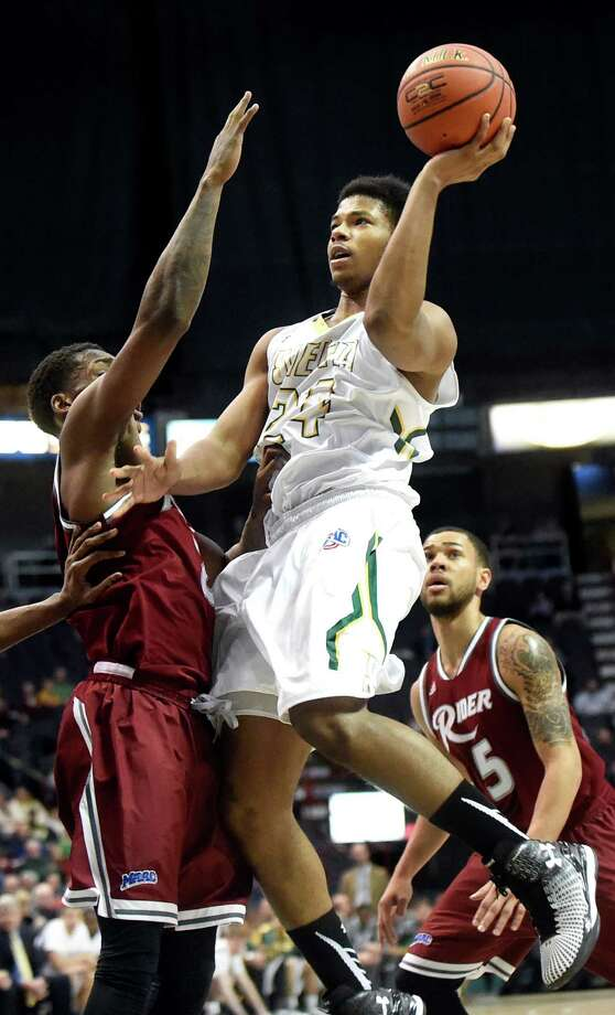 Siena's Lavon Long, right, shoots for the hoop as Rider's Zedric Sadler defends during their basketball game on Thursday, Jan. 21, 2016, at Times Union Center in Albany, N.Y. (Cindy Schultz / Times Union) Photo: Cindy Schultz / 10034934A
