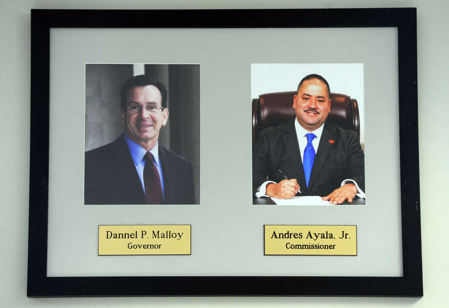 Portaits of Gov. Dannel P. Malloy and Motor Vehicles Commissioner Andres Ayala hang in the Bridgeport DMV offices. Photo: Ned Gerard / Hearst Connecticut Media / Connecticut Post