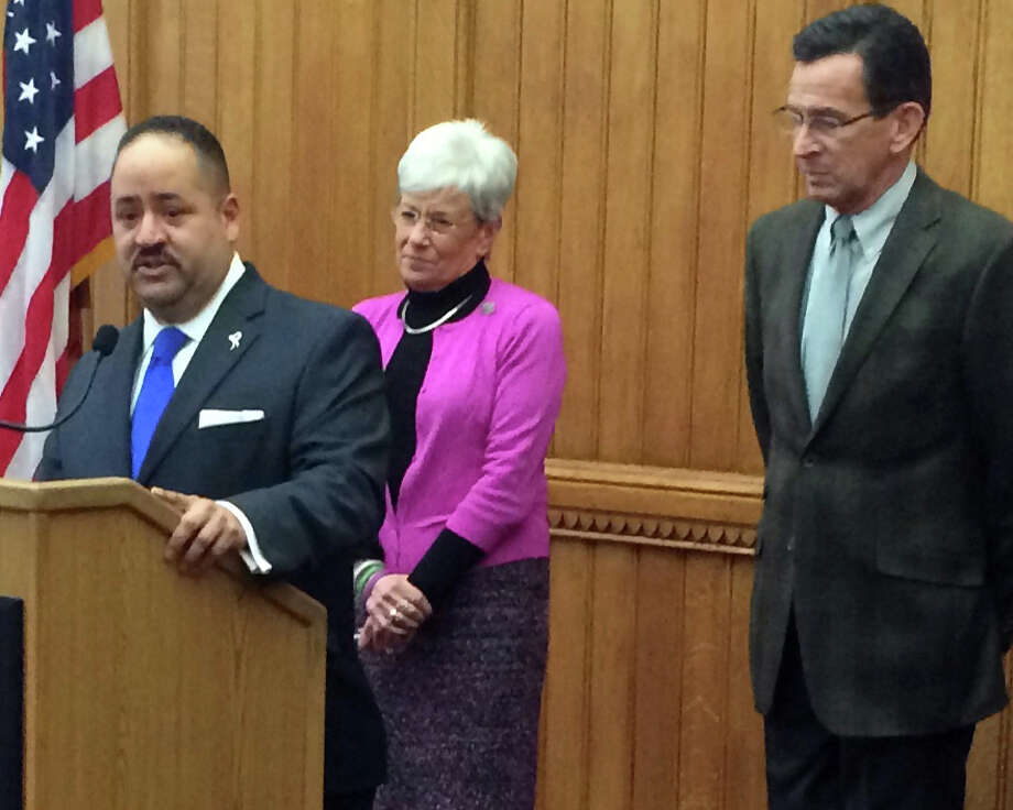 On Dec. 22, 2014 Governor Dannel Malloy appointed Andres Ayala, of Bridgeport, seen speaking here as Commissioner of the Department of Motor Vehicles. They are seen here with Lt. Governor Nancy Wyman. Photo: Contributed Photo / Contributed Photo / Connecticut Post Contributed