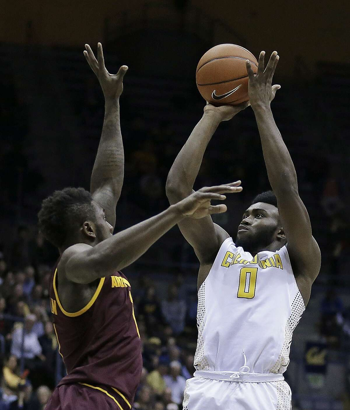 California's Jaylen Brown, right, shoots over Arizona State's Savon Goodman in the second half of an NCAA college basketball game Thursday, Jan. 21, 2016, in Berkeley, Calif.