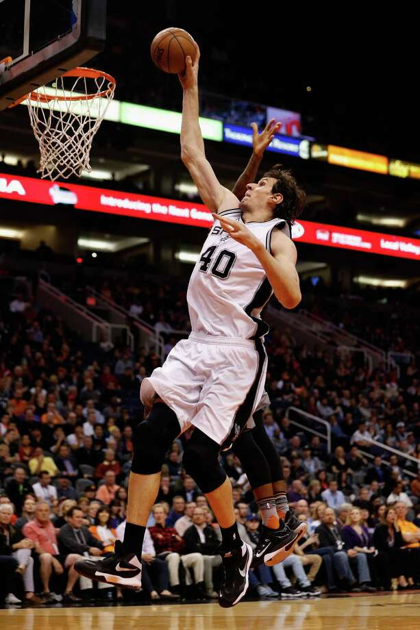PHOENIX, AZ - JANUARY 21:  Boban Marjanovic #40 of the San Antonio Spurs slam dunks the ball past Archie Goodwin #20 of the Phoenix Suns during the second half of the NBA game at Talking Stick Resort Arena on January 21, 2016 in Phoenix, Arizona.  The Spurs defeated the Suns 117-89. NOTE TO USER: User expressly acknowledges and agrees that, by downloading and or using this photograph, User is consenting to the terms and conditions of the Getty Images License Agreement. Photo: Christian Petersen, Getty Images / 2016 Getty Images