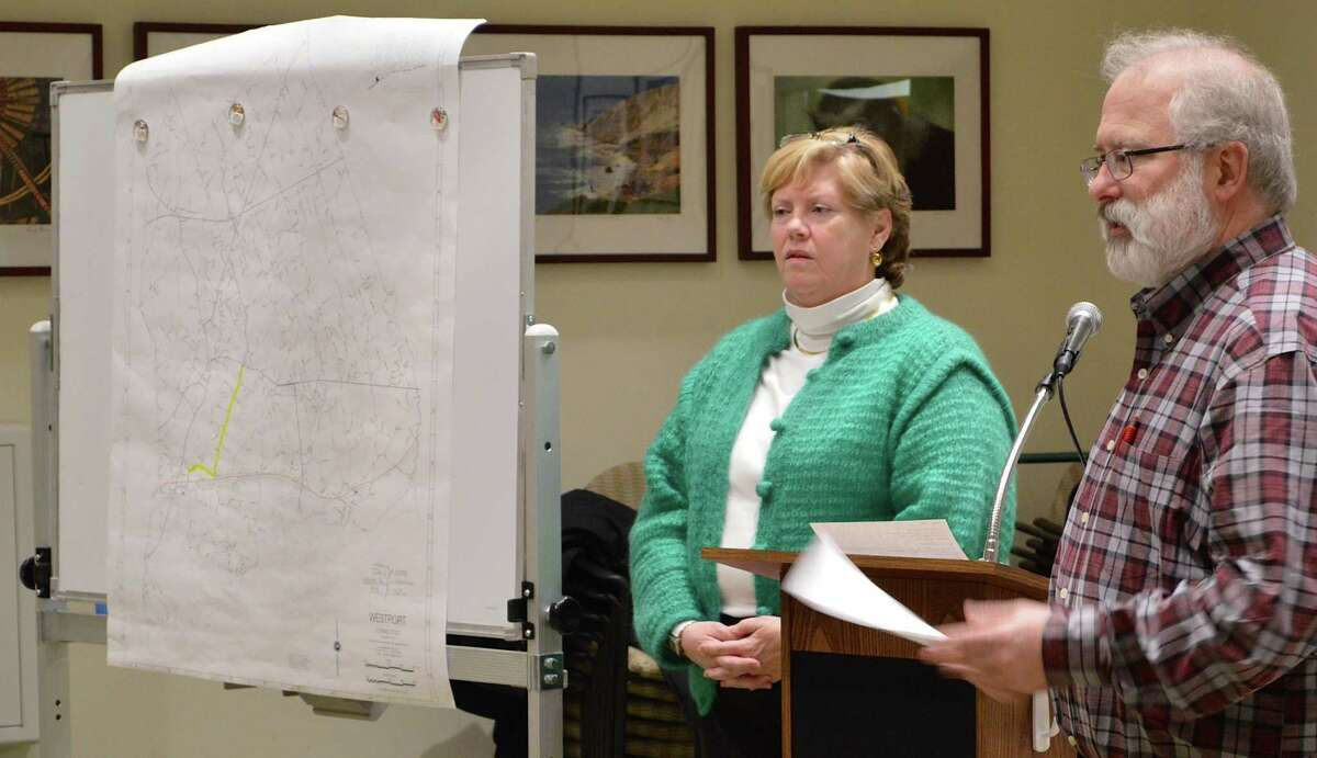 Colleen Kissane, chairwoman of the state's Scenic Road Advisory Committee, and John Suggs, RTM District 5, stand near a map marking the proposed section of Route 136 that could be designated a state scenic road if approved by the state Department of Transportation.