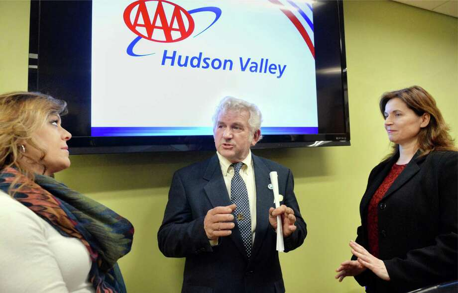 Carolyn Bonifas Kelly, left, of TRIP, a national nonprofit transportation research group based in Washington, DC, Canaan Superintendent of Highways, Bernhard Meyer and Nancy McMahon of AAA Hudson Valley, right, speak during a news conference to release a report saying that the poor condition of roads costs Albany drivers $2,000 a year Thursday, Jan. 21, 2016 in Albany, NY.  (John Carl D'Annibale / Times Union) Photo: John Carl D'Annibale / 10035083A