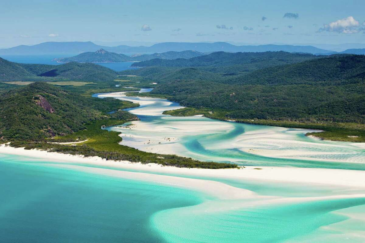 Whitehaven Beach, Australia: This paradise is known for it's white sands consisting of mostly silica giving this beach its signature color.