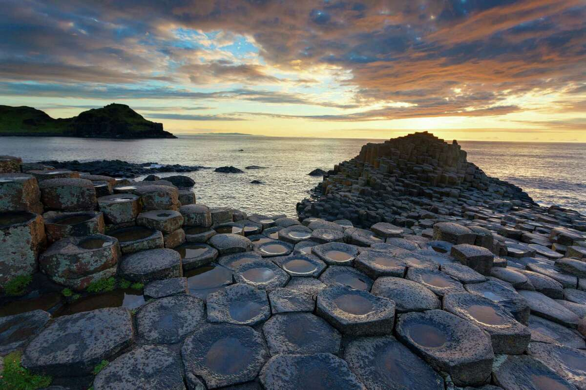 Giants Causeway Beach, Ireland: Located on the northeast cost of Northern Ireland, this unique structure consists of close to 40,000 basalt columns, which are said to be the result of an ancient volcanic eruptions.