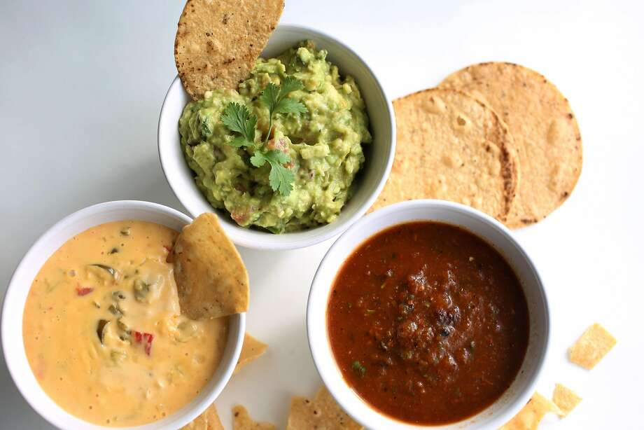 These dips for the Super Bowl are all Mexico-inspired, from left: Tacolicious' Chile con Queso, Classic Guacamole, and La Palma's Chile Casera Salsa. Photo: Liz Hafalia, The Chronicle