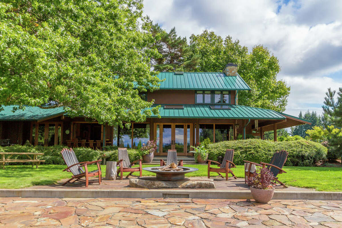 This really isn't a house so much as an estate on Bainbridge Island. It includes more than 9 acres and a guesthouse and bunkhouse. The full listing is here.