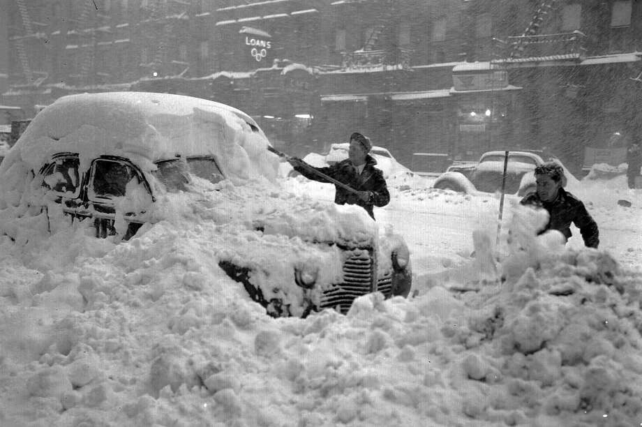 Two New Yorkers dig out a car on December 26, 1947. In the two-day period of Dec. 26 and 27th, 1947, New York City recorded a snowfall of 26.4 inches. Photo: ASSOCIATED PRESS / AP1947