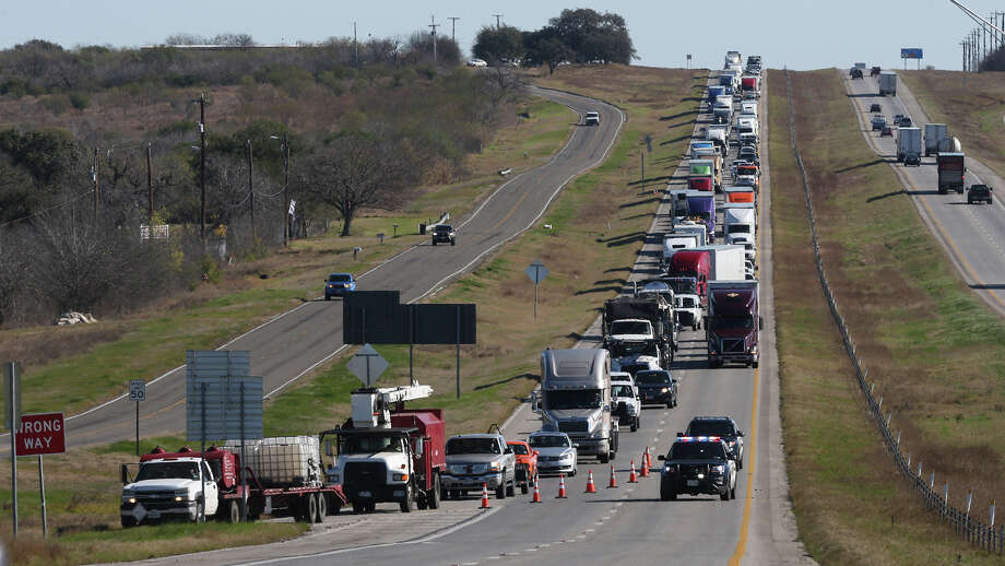 San Antonio police have completely shut down westbound Interstate 10 on the far East Side following a major crash that left one woman seriously injured Friday morning. San Antonio Police Department Sgt. Walter Smith said the woman was one of two passengers in a four-door sedan headed west on the interstate when it slammed into a guard rail around 9:30 a.m. near the exit for Pfeil Road, which is just outside Loop 1604. Smith said the woman was thrown into the windshield of the car during the crash, causing it to shatter and throw glass in front of the vehicle. The man driving the car was being evaluated for DWI at the scene. Smith said the woman's injuries appear to be non-life threatening and she was transported to an area hospital. The second female passenger was also detained for questioning.  More details will be added to this developing story as they become available. Photo: John Davenport, San Antonio Express-News / ©San Antonio Express-News/John Davenport