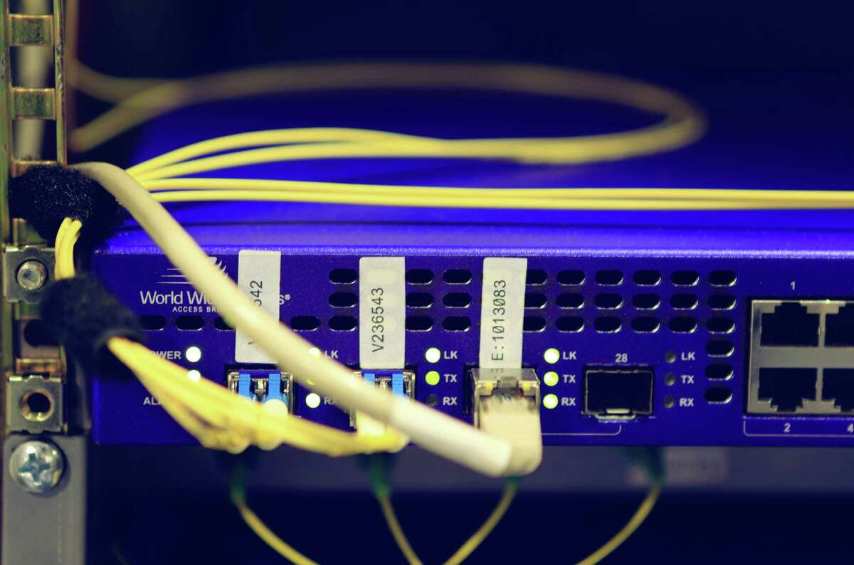 Network cables plugged in a router. LHJB-Photography via Getty