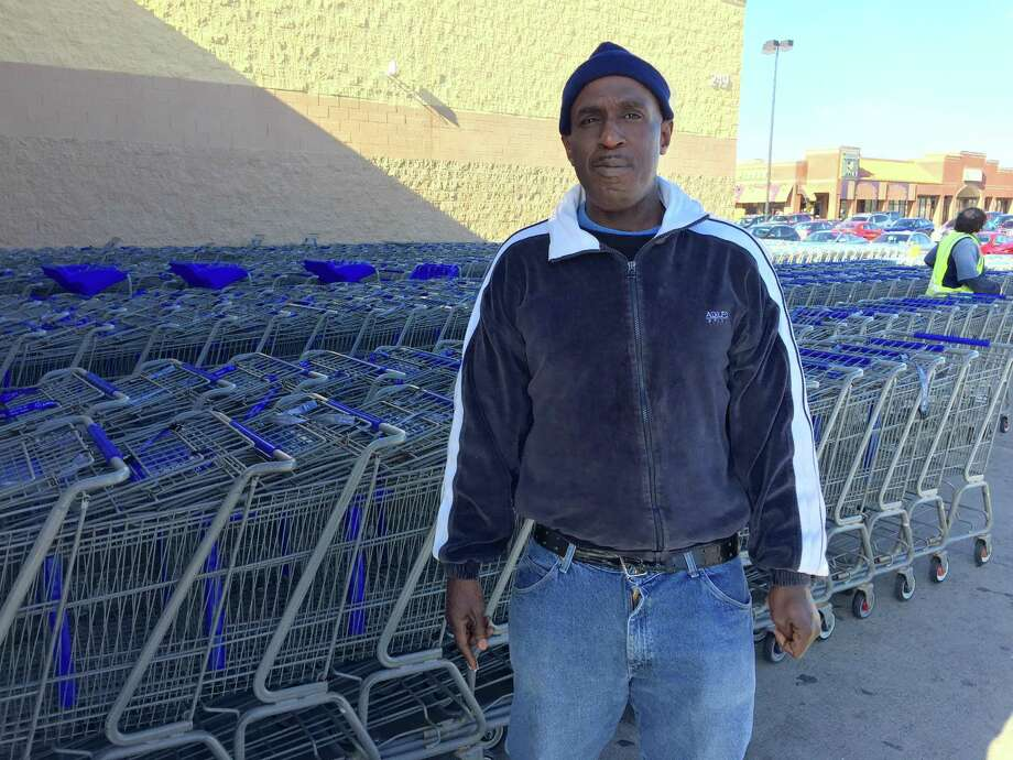 Thomas Smith, 52, of Albany, an ex-convict who was formerly homeless, was fired from his $9-an-hour job gathering shopping carts at the Wal-Mart Supercenter in East Greenbush after he redeemed $2 worth of empty cans and bottles discarded in the parking lot. (Paul Grondahl / Times Union)