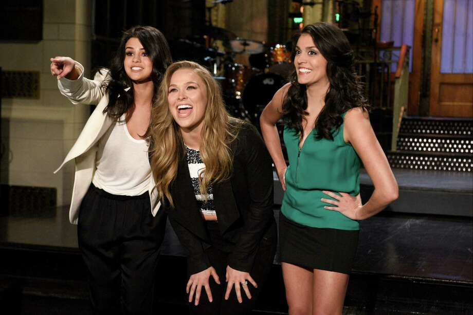 Ronda Rousey hosted Saturday Night Live with musical guest Selena Gomez (left). Rousey was just the third female athlete to ever host the show. Nancy Kerrigan and Chris Evert were the first two to host.Browse through the photos to see athlete appearances through the years on Saturday Night Live. Photo: NBC, Getty Images / 2016 NBCUniversal Media, LLC