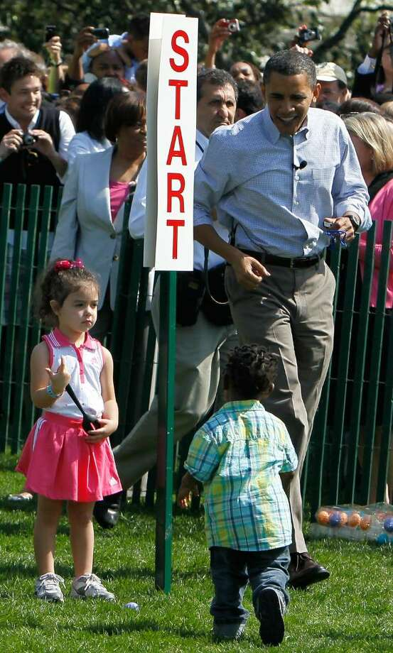 WASHINGTON - APRIL 05:  U.S. President Barack Obama (R) interacts with children during the annual White House Easter Egg Roll at the South Lawn April 5, 2010 in Washington, DC. The White House Easter Egg Roll is a tradition dating back to 1878 during the presidency of President Rutherford B. Hayes.  (Photo by Alex Wong/Getty Images) *** Local Caption *** Barack Obama Photo: Alex Wong, Getty Images / 2010 Getty Images