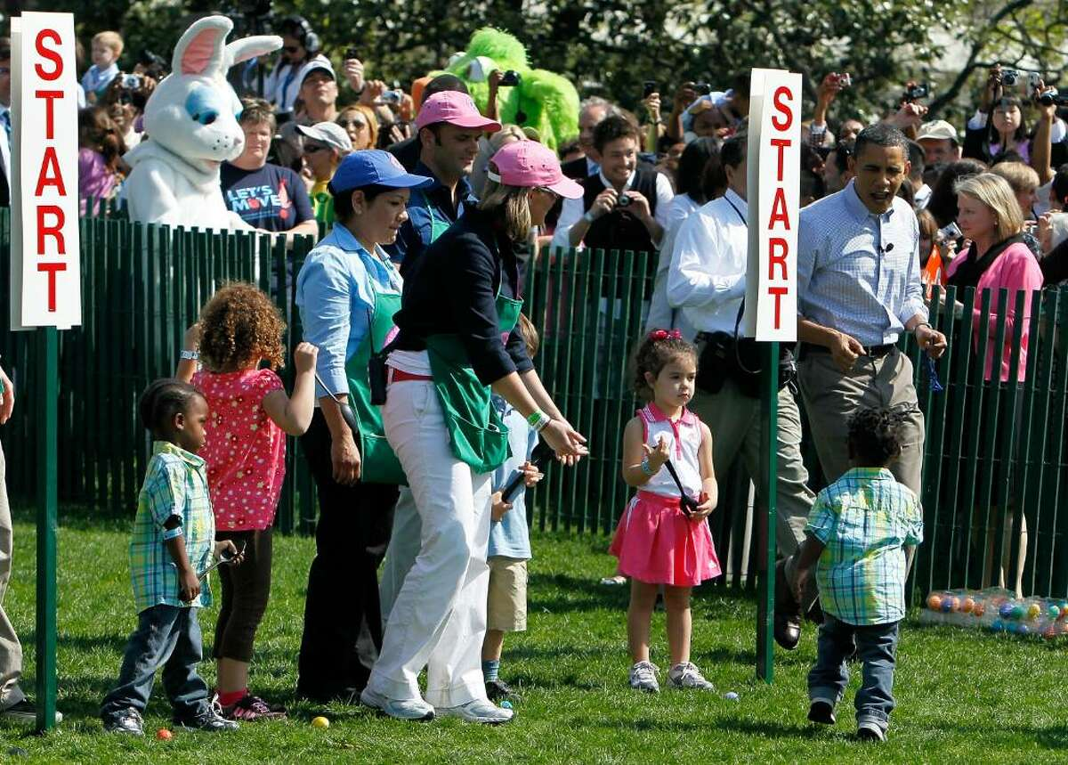 WASHINGTON - APRIL 05: U.S. President Barack Obama (R) interacts with children during the annual White House Easter Egg Roll at the South Lawn April 5, 2010 in Washington, DC. The White House Easter Egg Roll is a tradition dating back to 1878 during the presidency of President Rutherford B. Hayes. (Photo by Alex Wong/Getty Images) *** Local Caption *** Barack Obama