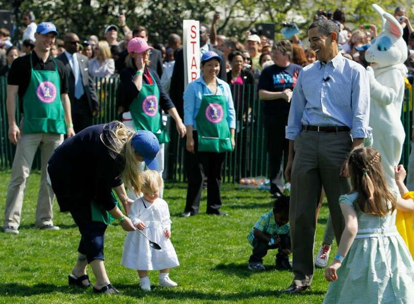 WASHINGTON - APRIL 05: U.S. President Barack Obama (R) watches as children participate during the annual White House Easter Egg Roll at the South Lawn April 5, 2010 in Washington, DC. The White House Easter Egg Roll is a tradition dating back to 1878 during the presidency of President Rutherford B. Hayes. (Photo by Alex Wong/Getty Images) *** Local Caption *** Barack Obama