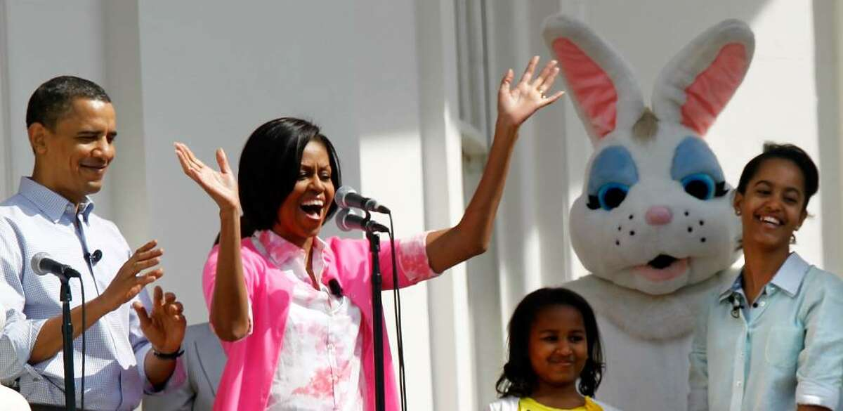 WASHINGTON - APRIL 05: U.S. first lady Michelle Obama (2nd L) speaks from the Truman Balcony as President Barack Obama (L), daughters Malia (R) and Sasha (3rd L) look on during the annual White House Easter Egg Roll at the South Lawn April 5, 2010 in Washington, DC. The White House Easter Egg Roll is a tradition dating back to 1878 during the presidency of President Rutherford B. Hayes. (Photo by Alex Wong/Getty Images) *** Local Caption *** Barack Obama;Michelle Obama;Malia Obama;Sasha Obama