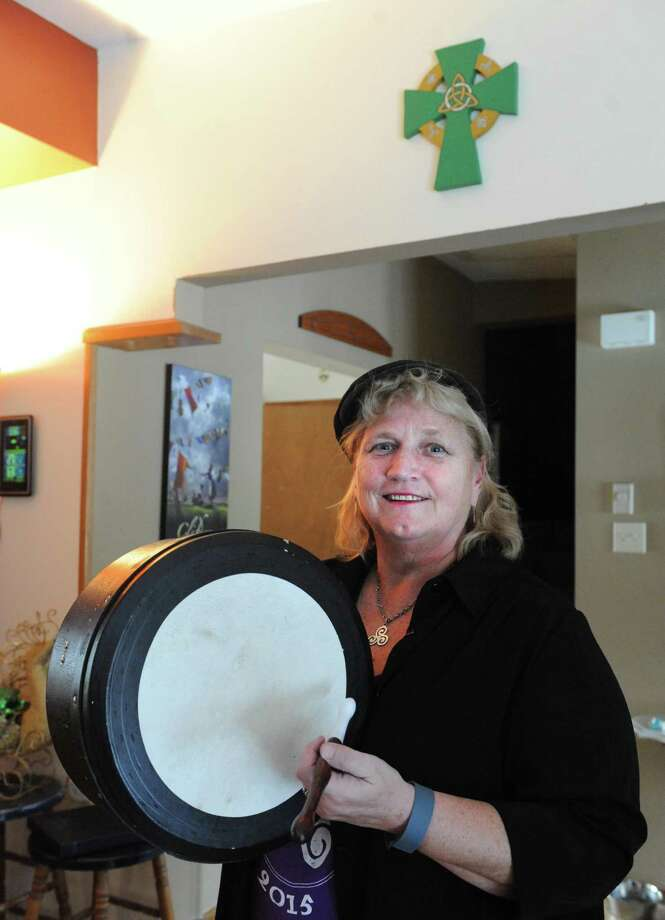Noeleen Druckenmiller founder of the trio and Irish band Triskele at her home with the instrument she plays, an Irish drum called a bodhran, on Wednesday Jan. 20, 2016 in Troy, N.Y. (Michael P. Farrell/Times Union) Photo: Michael P. Farrell / 10035069A