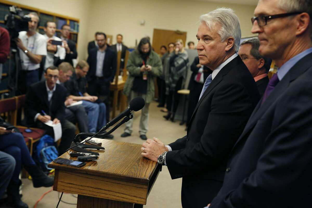 District Attorney George Gascón (third from right) announces the filing of felony, bribery and money laundering charges against former Human Rights Commission Commissioner Nazly Mohajer, former Human Rights Commission employee Zula Jones and political consultant Keith Jackson as he stands with City Attorney Dennis Herrera (second from right) and FBI Special Agent In Charge David Johnson (right) during a press conference at the District Attorney's office on Friday, January 22, 2016 in San Francisco, Calif.
