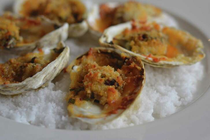 Roasted Gulf oysters with smoked chili butter and Manchego cheese at Brennan's, New Orleans.