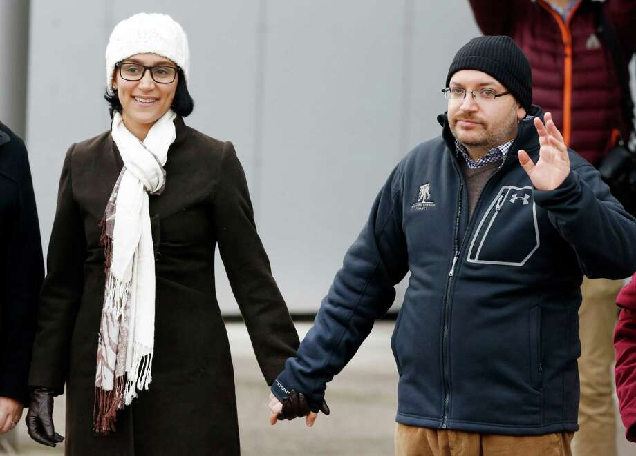 U.S. journalist Jason Rezaian and his wife Yeganeh Salehi hold hands as they pose for media people in front of Landstuhl Regional Medical Center in Landstuhl, Germany, last week. Rezaian was released from an Irani prison last Saturday. Photo: Michael Probst /Associated Press / AP