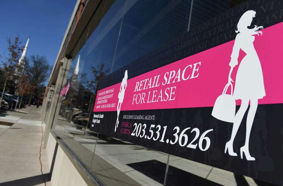"""A """"For Lease"""" sign is displayed in the window of a closed business on Greenwich Avenue in downtown Greenwich, on Tuesday. Photo: Tyler Sizemore / Hearst Connecticut Media / Greenwich Time"""
