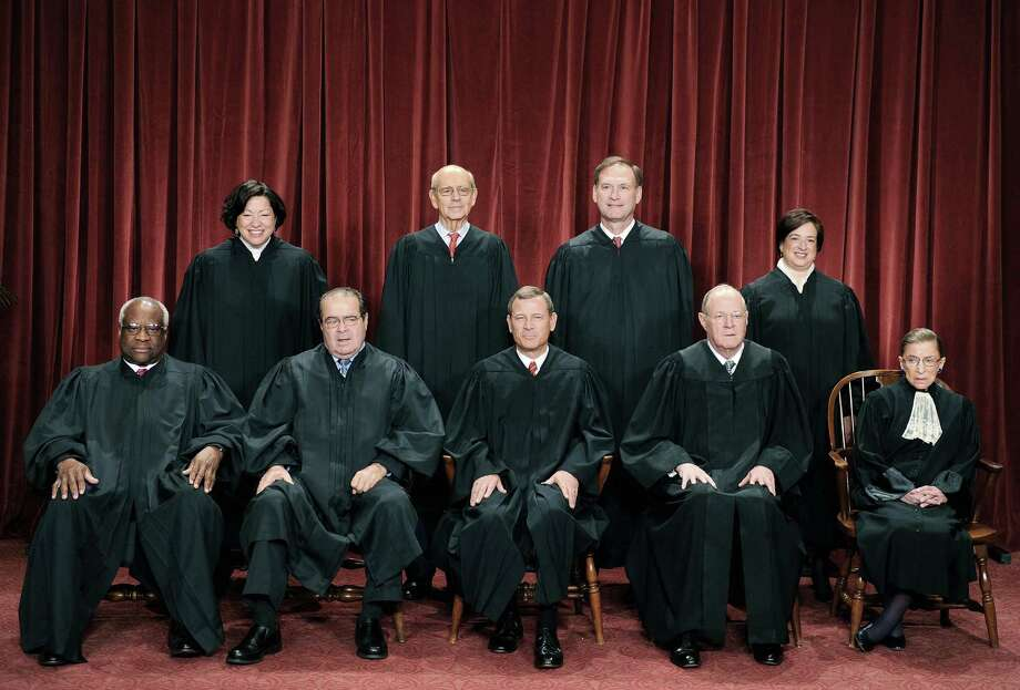 The Justices of the US Supreme Court sit for their official photograph in 2010 file photo at the Supreme Court in Washington, DC. Court nominations represent the biggest way presidents can shape public policy and American lives. Vote accordingly in 2016, looking for the candidate most likely to share your views. Photo: TIM SLOAN /AFP /Getty Images / AFP ImageForum