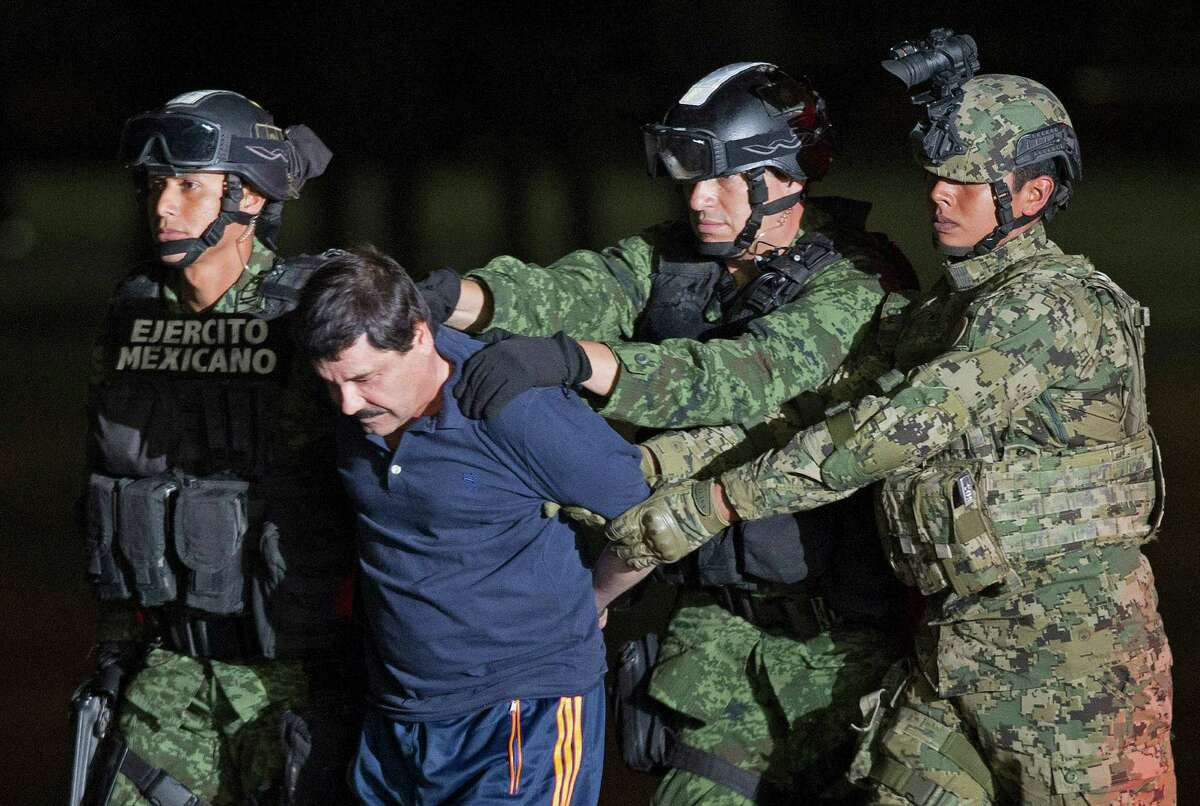 Mexican army soldiers escort drug lord Joaquin