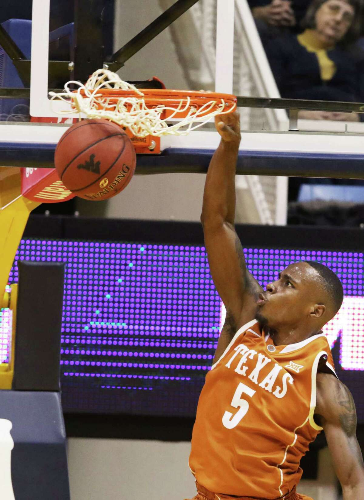 Texas guard Kendal Yancy dunks the ball during the second half against West Virginia on Jan, 20, 2016, in Morgantown, W.Va. Texas defeated West Virginia 56-49.
