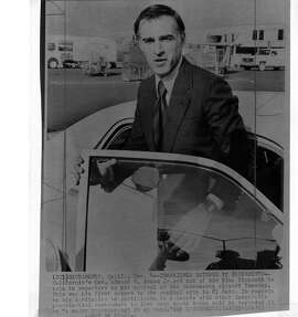 Governor Jerry Brown talks to reporters as he gets out of his blue Plymouth  photo ran 12/5/1979, p.18